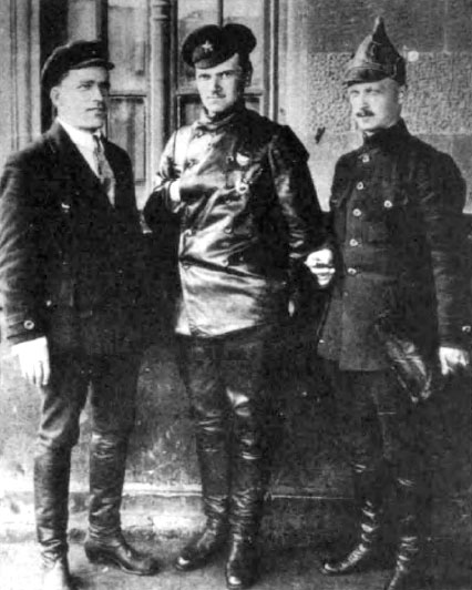 Mikhail Levandovsky (center), gives the hidden hand for the photo. Flanked by Sergei Kirov (left) and Konstantin Mekhonoshin (right). These three men were deeply involved the bloody 1917 Communist Russian Revolution