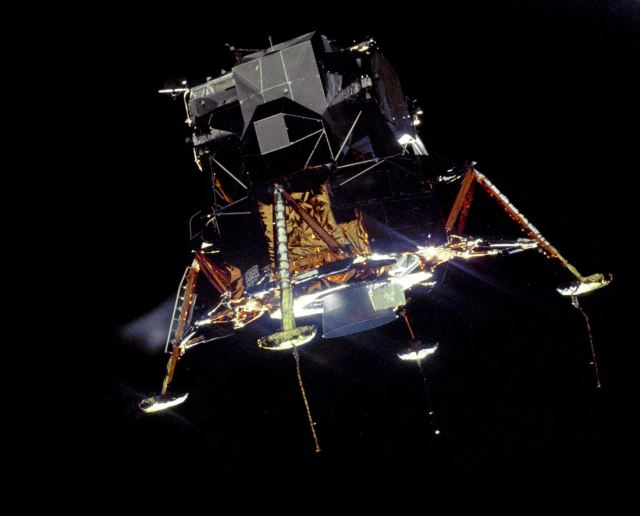 Apollo_11_Lunar_Module_Eagle_in_landing_configuration_in_lunar_orbit_from_the_Command_and_Service_Module_Columbia