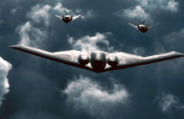 FILE PHOTO -- A B-2 Spirit bomber is followed by two F-117 Nighthawks during a mission. The B-2 is a multi-role bomber capable of delivering both conventional and nuclear munitions. A dramatic leap forward in technology, the bomber represents a major milestone in the U.S. bomber modernization program. The B-2 brings massive firepower to bear, in a short time, anywhere on the globe through previously impenetrable defenses. (U.S. Air Force photo)